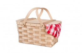 A new wicker and wood picnic basket with a red checkered tablecl