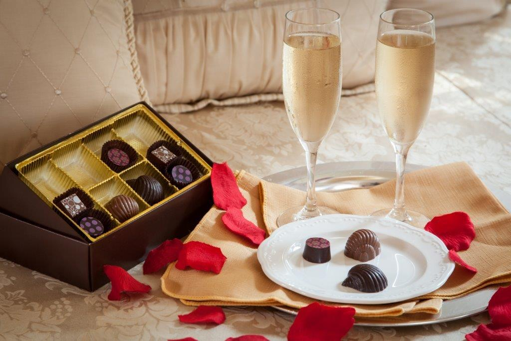 Rose petals, chocolates, and sparkling wine at our Maine B&B