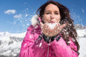 Women blowing snow at Camden Snow Bowl