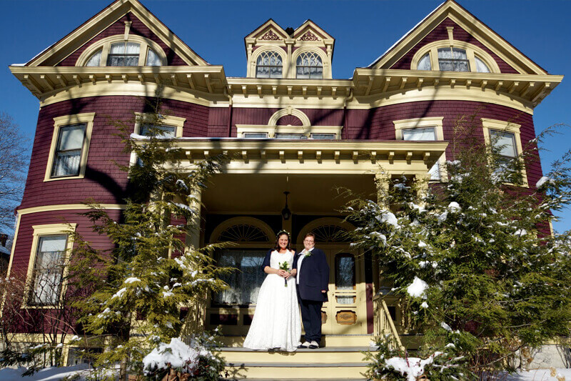 Same sex couple getting married in the winter in Maine when they elope to Berry Manor Inn