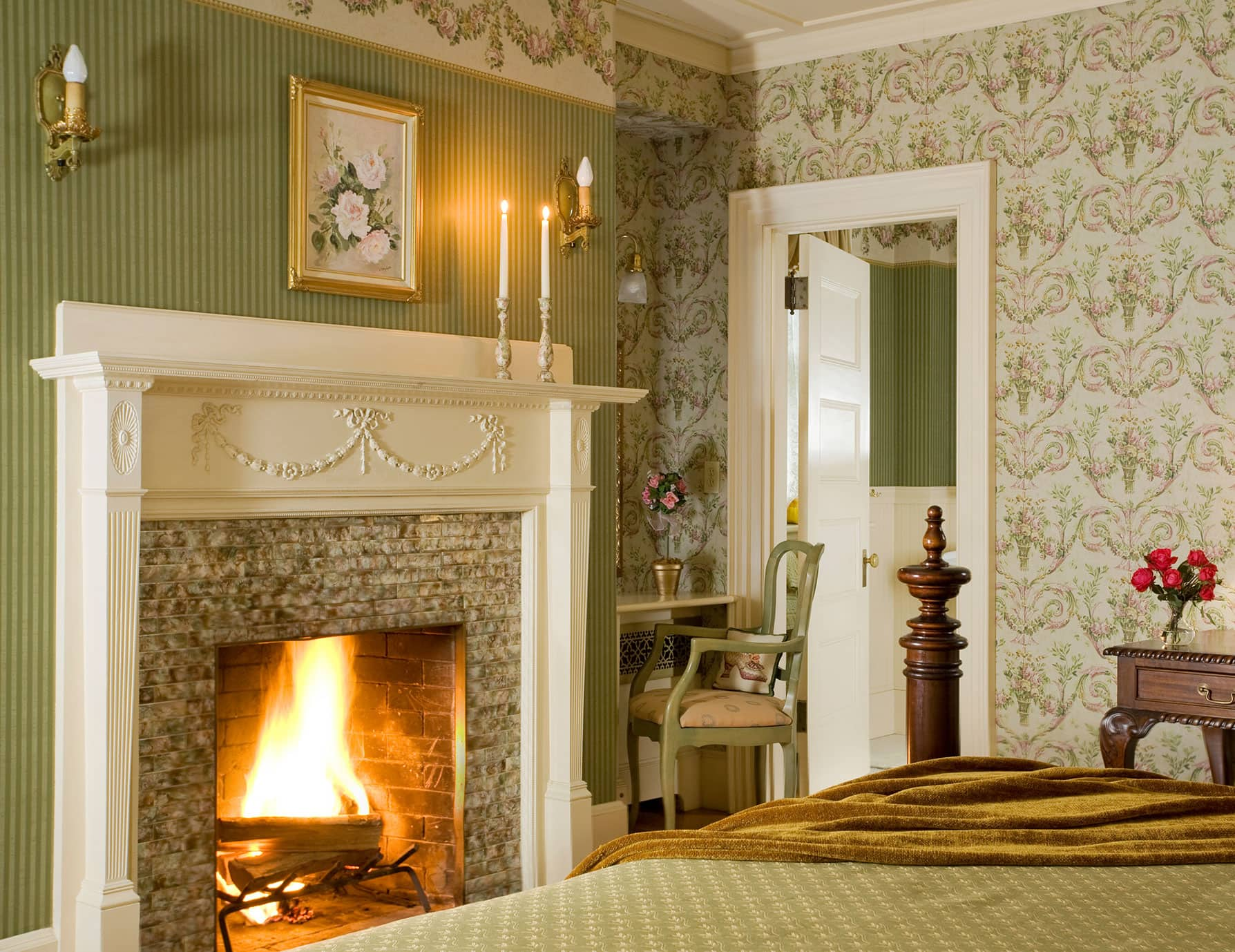 Warm fireplace at the foot of the bed in Room 1