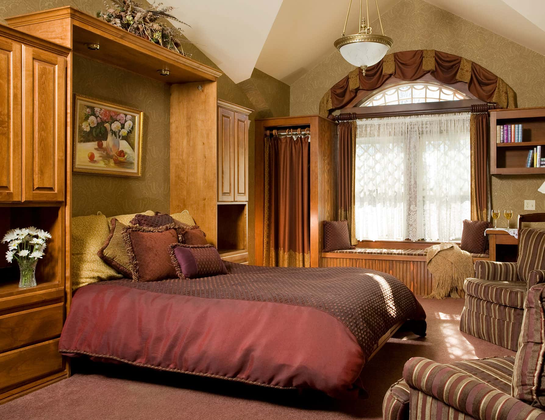 Plush Murphy bed in the wood-furnished Room 10