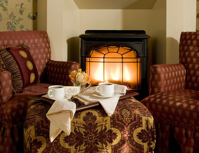 Tray of coffee in front of fireplace
