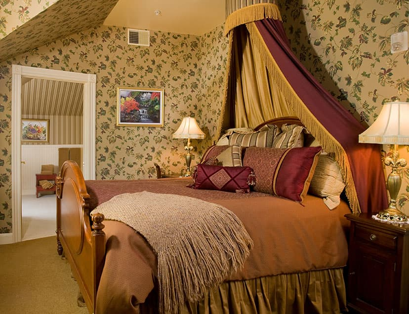 Lavish bed with canopy in Room 11