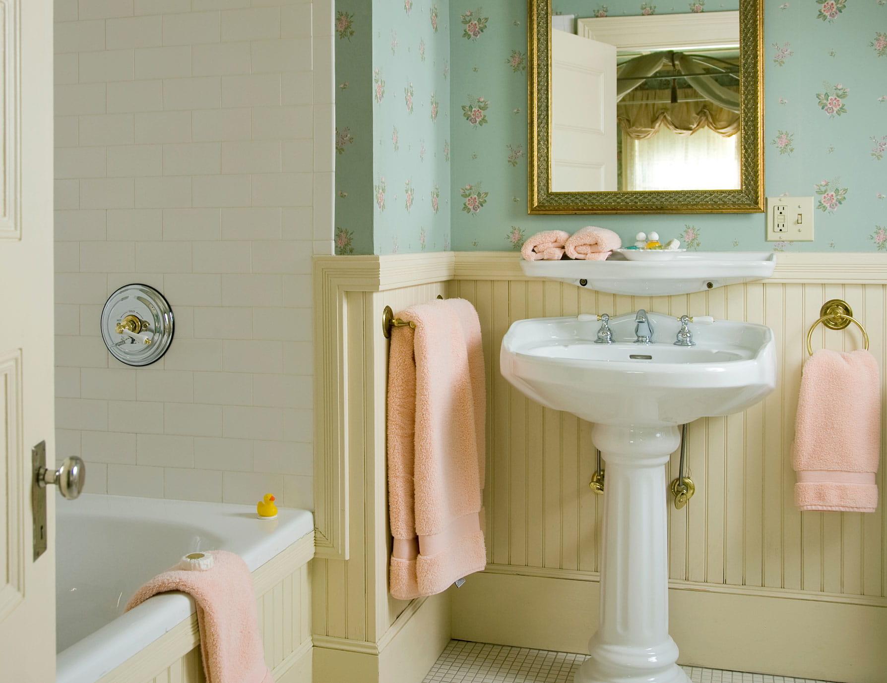 Sink by clean towels and bathtub