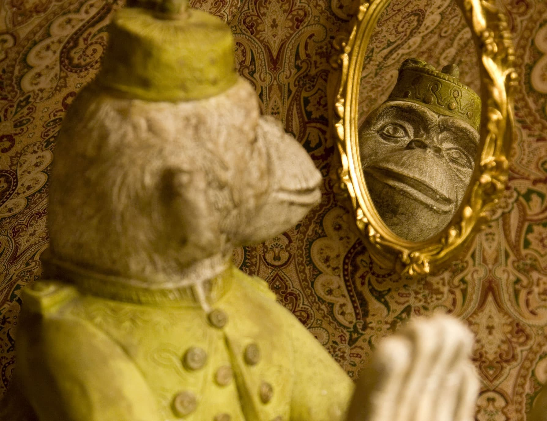 Fun monkey statuette looking in the mirror