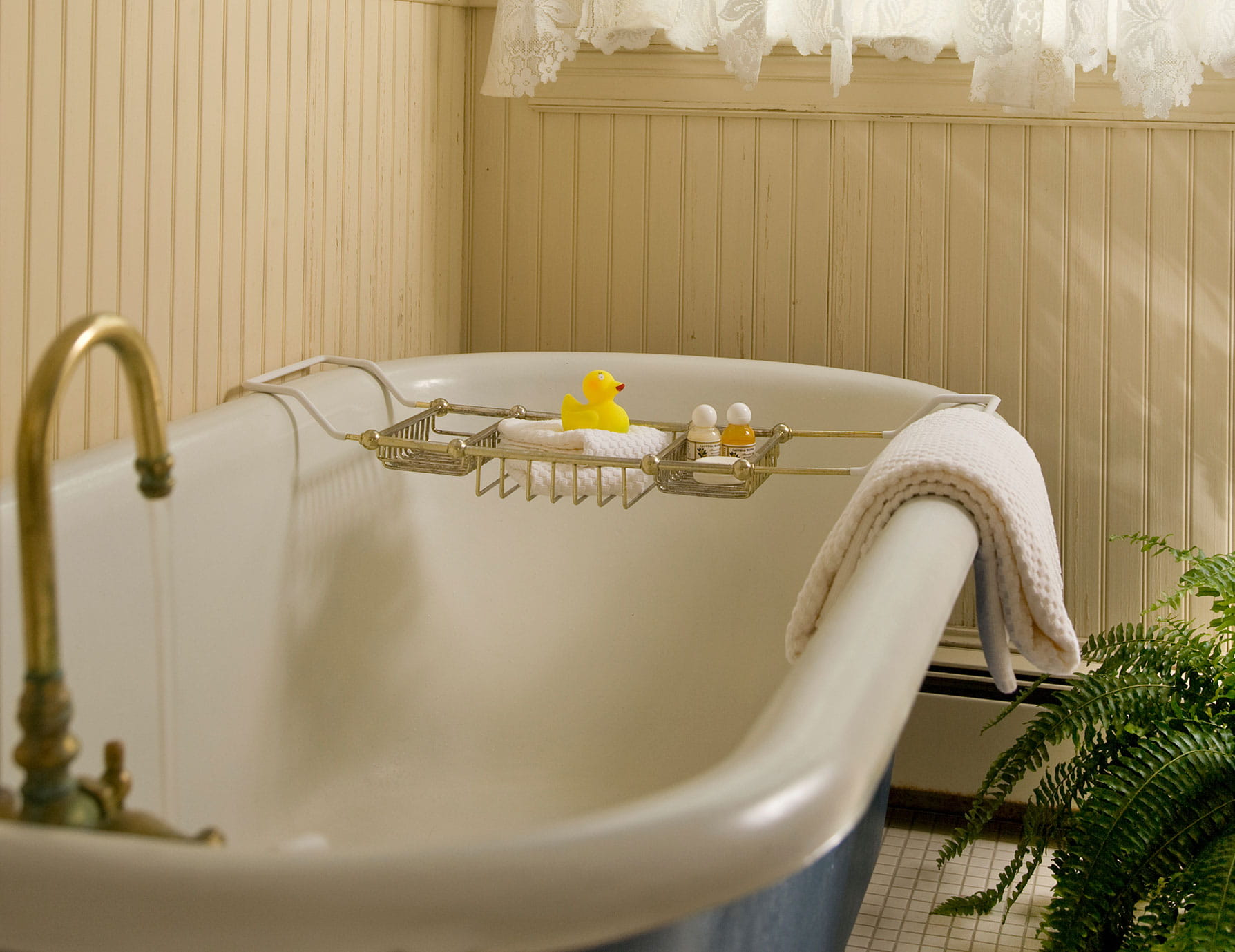 Warm bathtub with small supplies tray