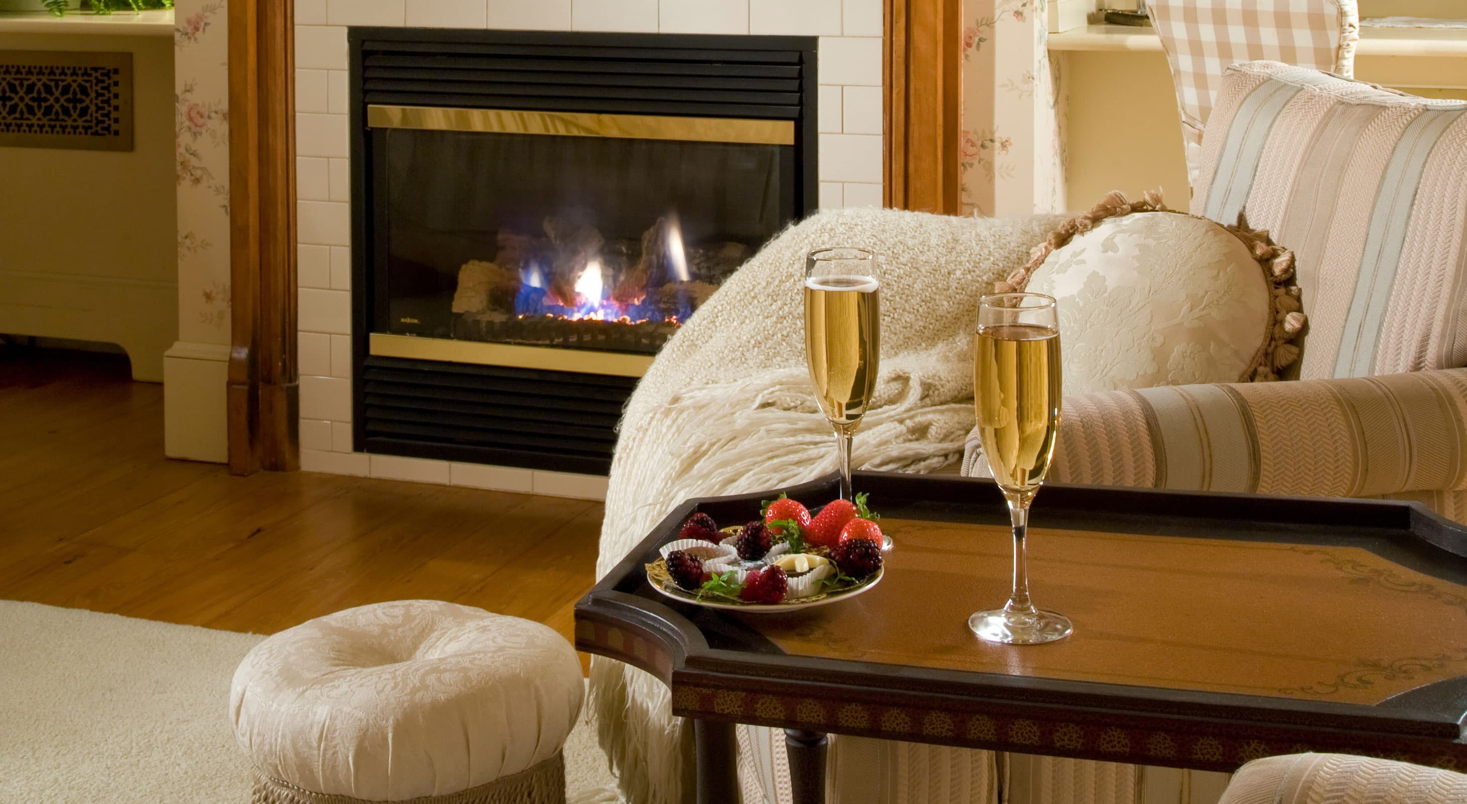 Champagne for two with chocolate strawberries in front of the fireplace in Room 3 at our bed and breakfast near Camden
