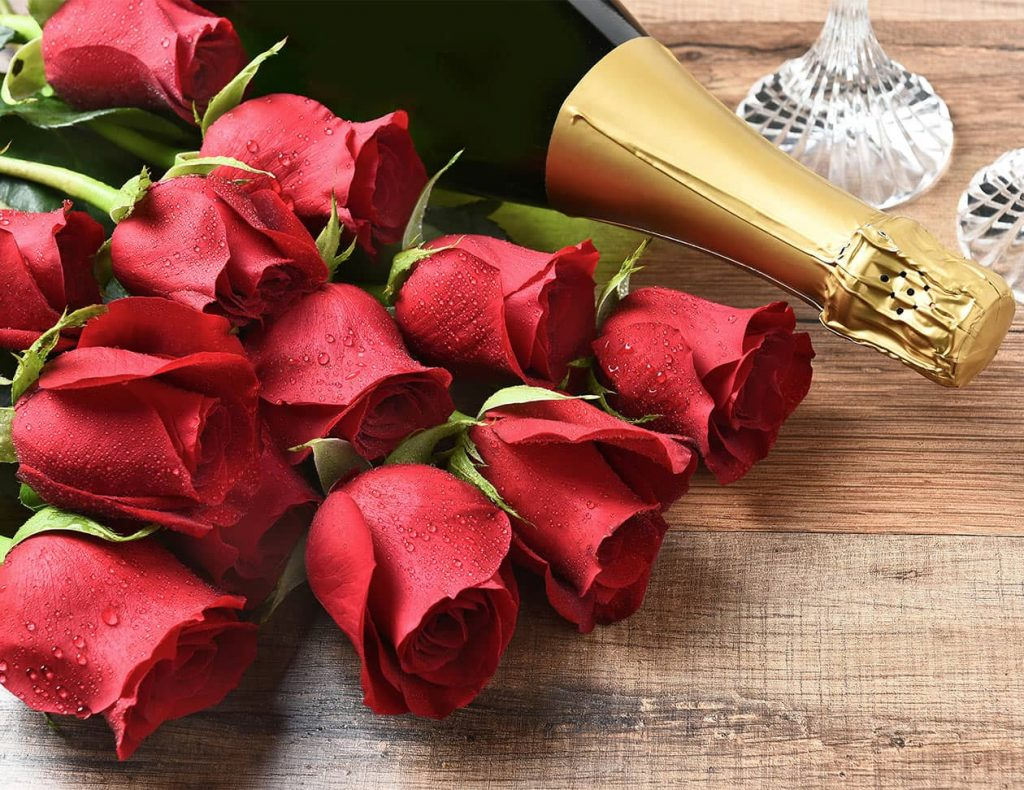 Bottle of Sparkling Wine and Red Roses