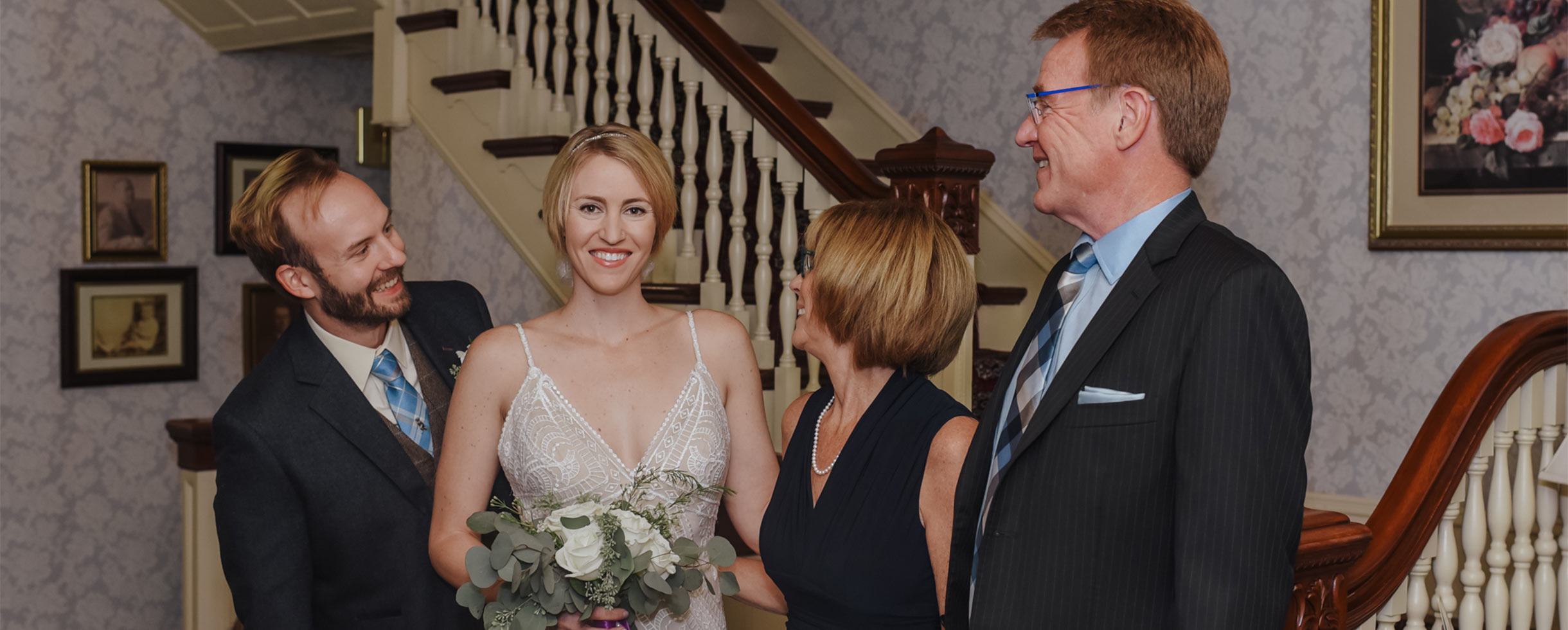 Bride and groom with two guests inside Berry Manor Inn