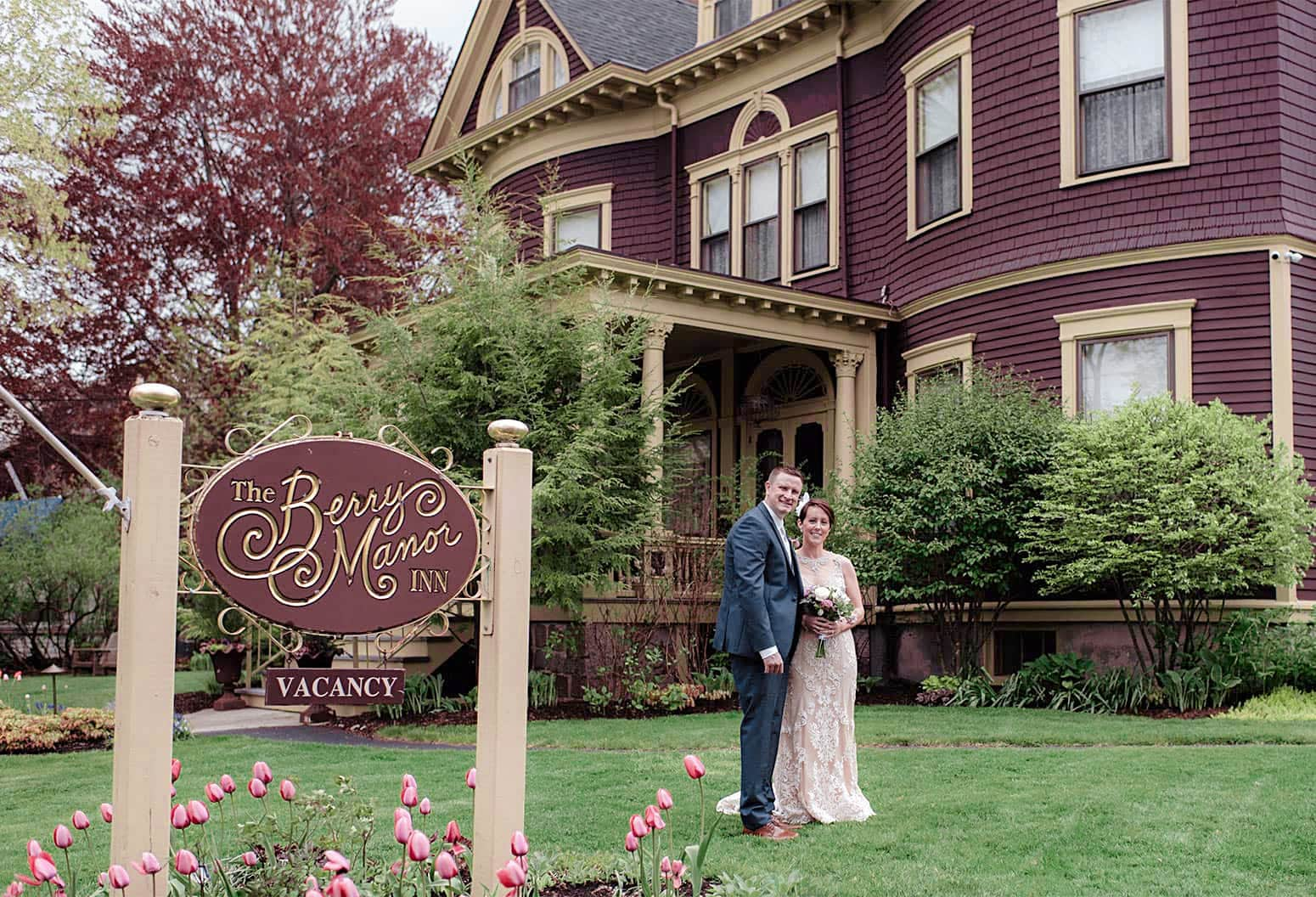 Bride and Groom in Lawn in front of Berry Manor Inn