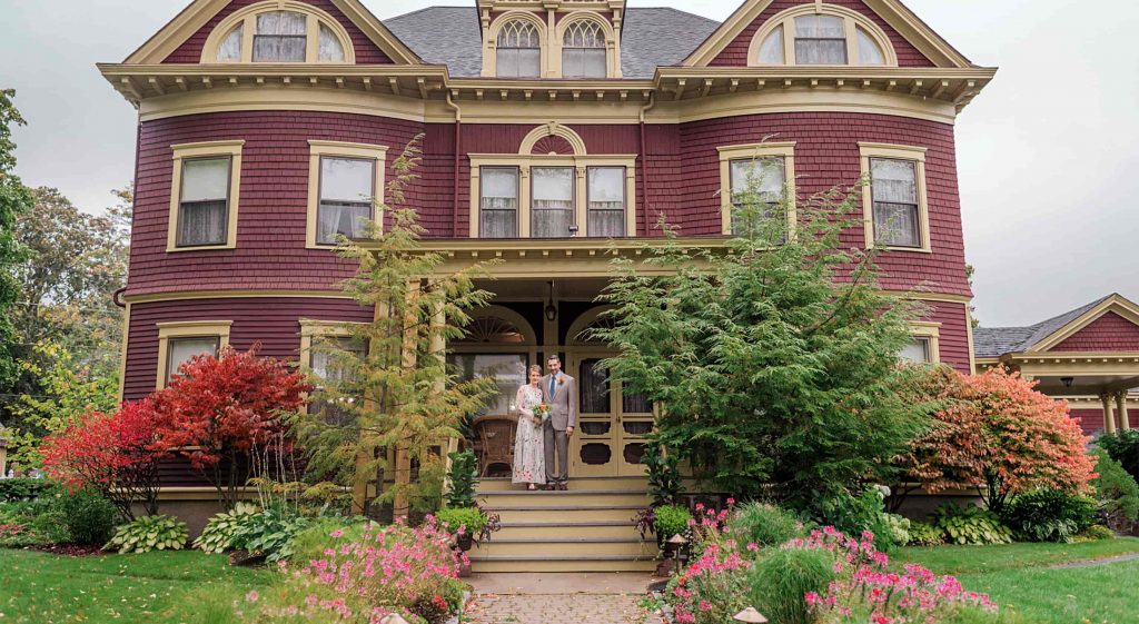 Bride and Groom on the Porch of Berry Manor Inn