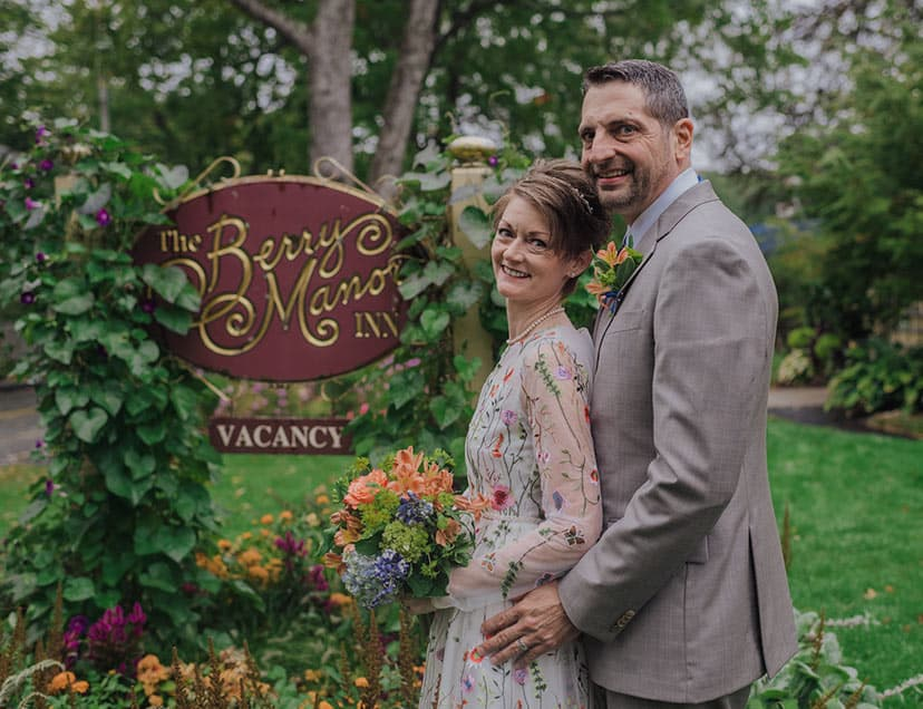 Bride and Groom by our sign