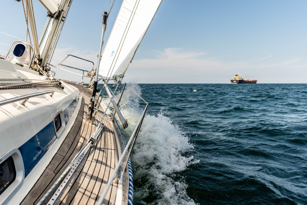 View from the side of a sailboat sailing through the open seas