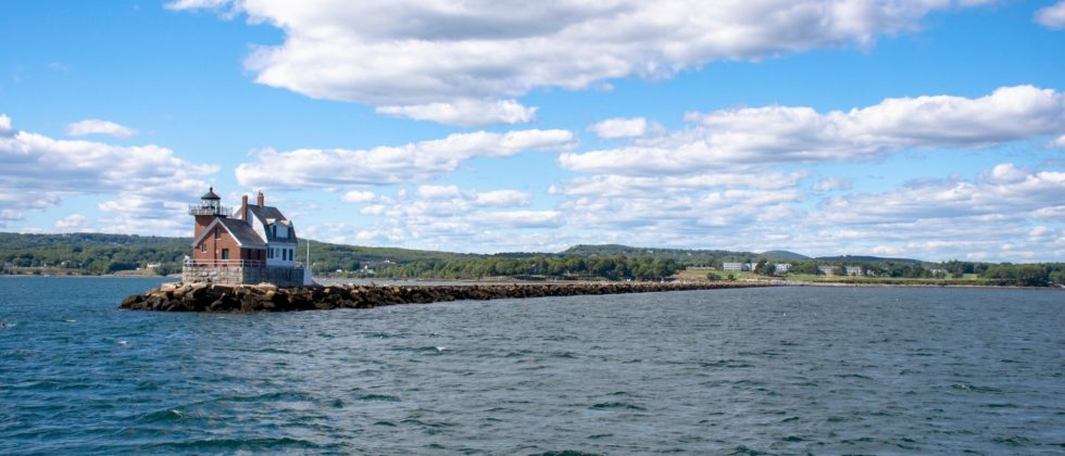 Breakwater Lighthouse on the tip of a narrow peninsula in Penobsoct Bay in Rockland Maine