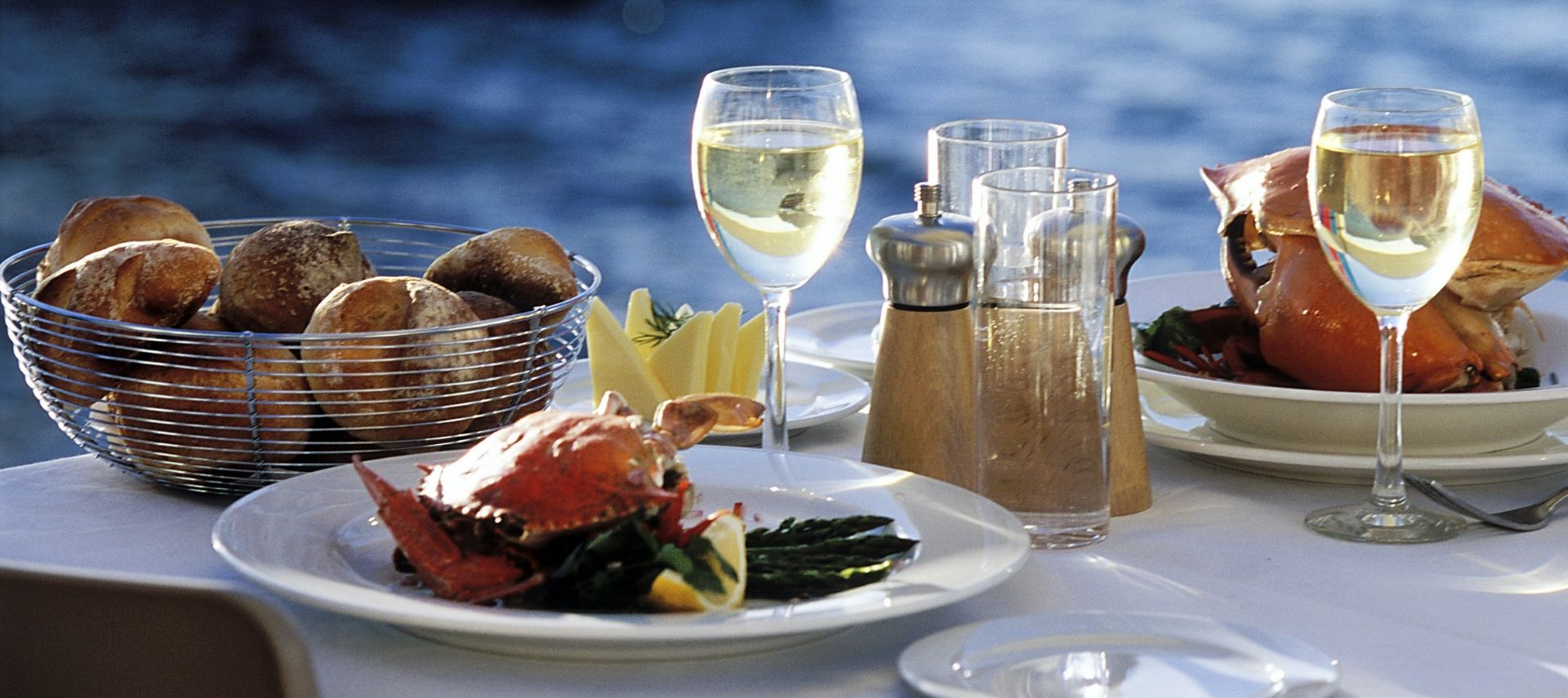 Dining table set with fresh seafood overlooking the water